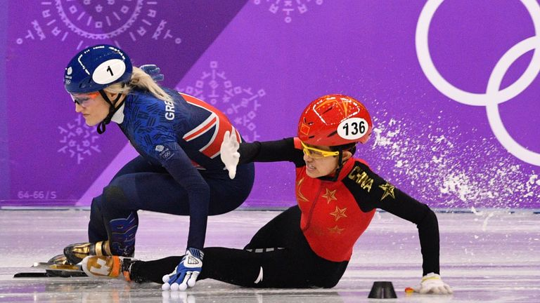 Britain's Elise Christie (L) and China's Li Jinyu crash in the women's 1,500m short track speed skating semi-final event during the Pyeongchang 2018 Winter Olympic Games, at the Gangneung Ice Arena in Gangneung on February 17, 2018