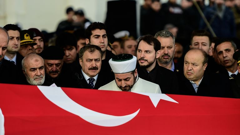 Turkey's Energy Minister Berat Albayrak (2nd R) and the father (R) and relatives of Fatih Mehmethan, a Turkish soldier killed in cross-border clashes with Kurdish People's Protection Units (YPG) forces in Afrin