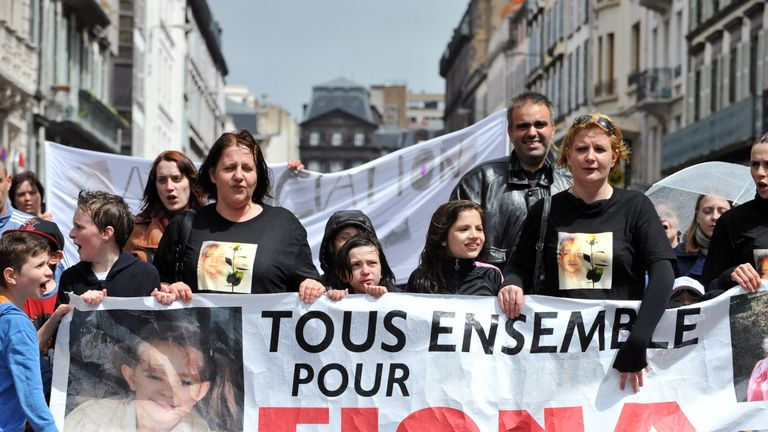 """People take part in a """"white march for Fiona"""" on May 11, 2014 in Clermond Ferrand, southern France"""