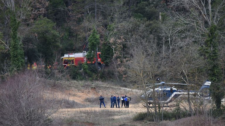 French gendarmes and firefighters work at the site of an accident near Carces lake, about 50 kilometres (30 miles) northwest of the resort of Saint-Tropez