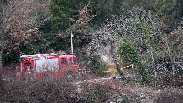 Firefighters work at the site of an accident near Carces lake, about 50 kilometres (30 miles) northwest of the resort of Saint-Tropez