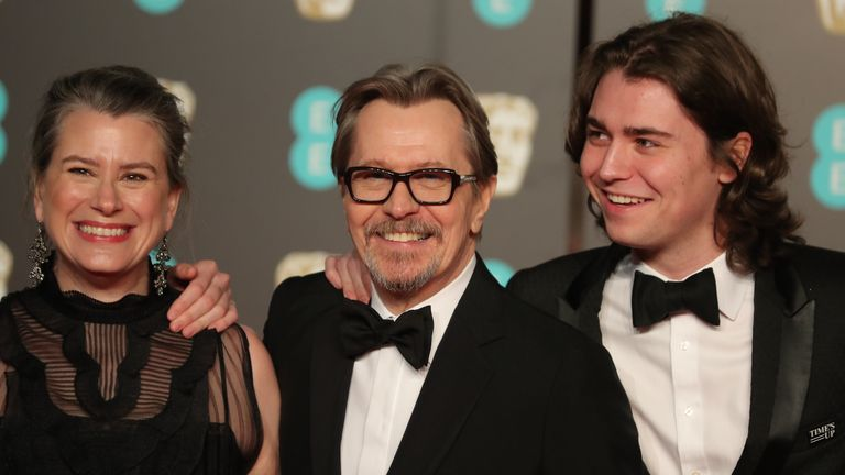 LONDON, ENGLAND - FEBRUARY 18: gary oldman at the baftas with his family
