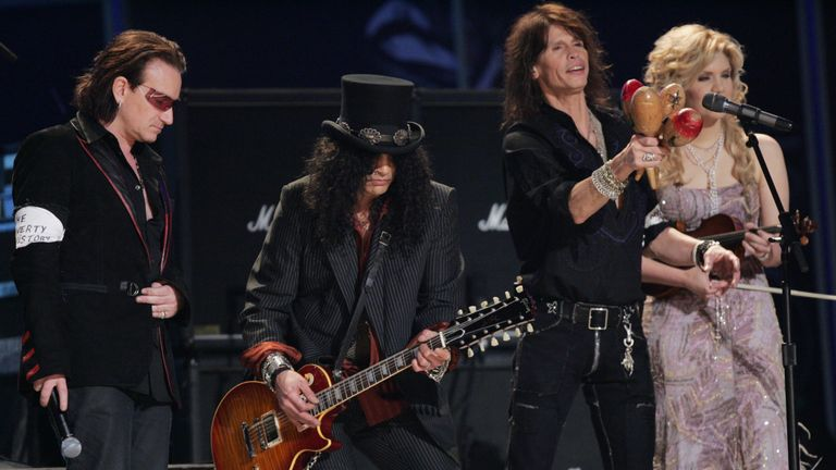 Musicians Bono, Slash, Steven Tyler and Allison Krauss perform with a Gibson guitar