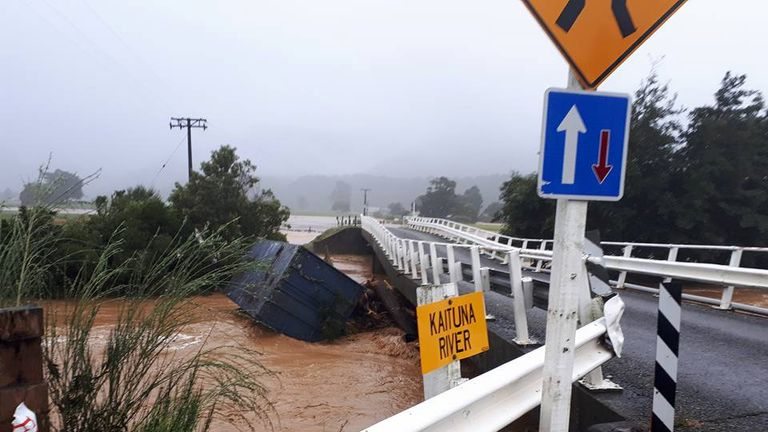 Debris is carried by a river in Bainham, New Zealand February 20, 2018 in this picture obtained from social media. Pic: Billy Haldane via Reuters