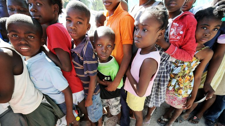 Young Haitian earthquake victims lineup to get some food donations at a refugee camp in Port-au-Prince on January 18, 2010 after the country was rocked by a massive 7.0-magnitude quake on January 12, 2010