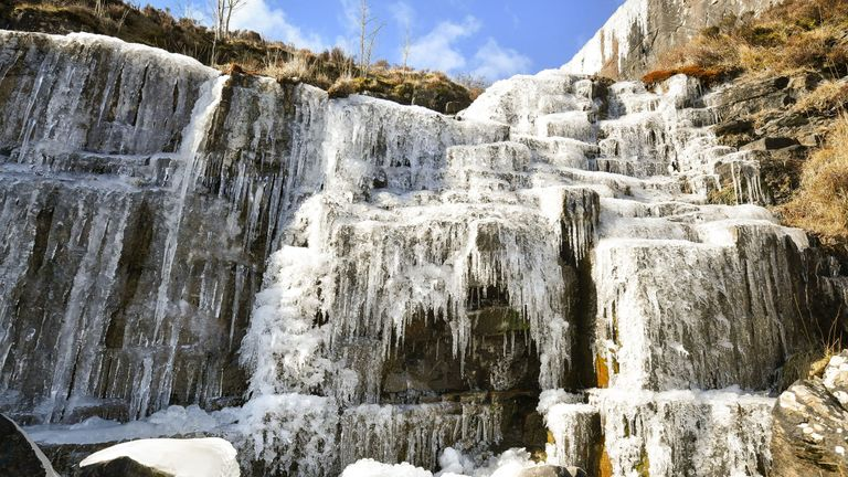 Icicles formed on a frozen waterfall near Pen y Fan mountain on Brecon Beacon National Park, Wales