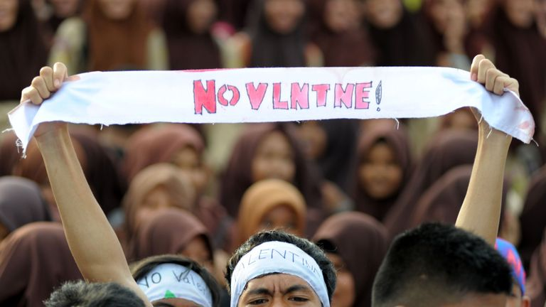 Indonesian Muslim students campaign against the celebration of Valentine's Day in Banda Aceh on February 13, 2016. Muslim clerics across Indonesia have warned against celebrating Valentine's Day, which they regard as Western celebration that promotes sex, drinking alcohol and drug use. AFP PHOTO / Chaideer MAHYUDDIN / AFP / CHAIDEER MAHYUDDIN (Photo credit should read CHAIDEER MAHYUDDIN/AFP/Getty Images)