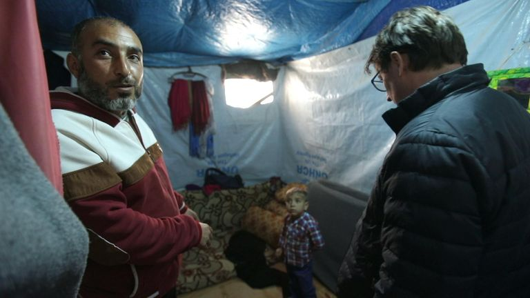 Syrian refugee Mohammed Abu Malek and one of his young children