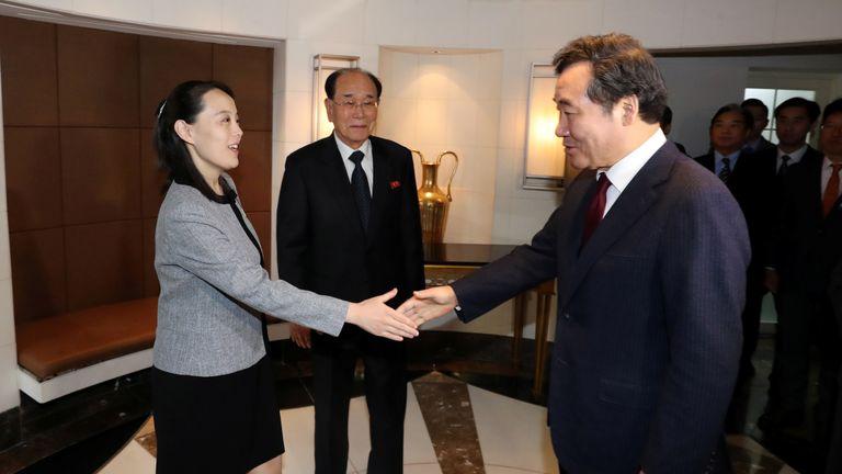 Kim Yo Jong, the sister of North Korea's leader Kim Jong Un, is greeted by South Korea's Prime Minister Lee Nak-yeon