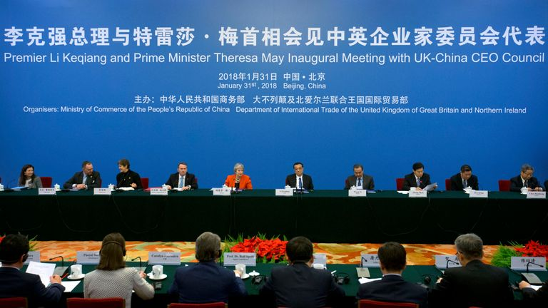 BEIJING, CHINA - JANUARY 31: (4th L-R) British Secretary of State for International Trade Liam Fox, British Prime Minister Theresa May and Chinese Premier Li Keqiang listen to a speaker during the inaugural meeting of the UK-China CEO Council at the Great Hall of the People on January 31, 2018 in Beijing, China.