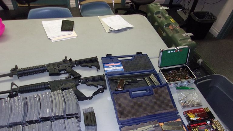 Police found two AR-15 assault rifles, two handguns and 90 high-capacity ammunition magazines