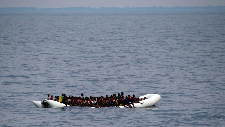 "Migrants on a dinghy are seen being rescued by ""Save the Children"" NGO crew from the ship Vos Hestia in the Mediterranean sea off Libya coast"