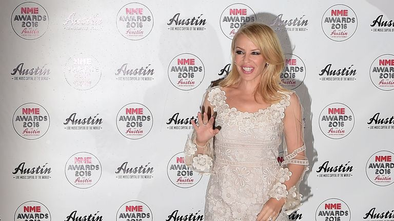 Australian singer Kylie Minogue posing on the red carpet
