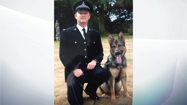 PC Dave Wardell and his police dog, Finn, were chasing a robbery suspect in 2016 when they were attacked with a knife. - GIVEN BY PR