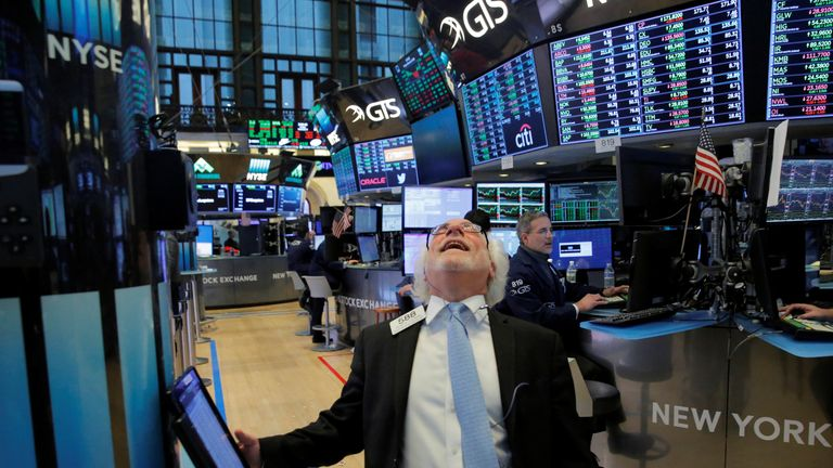 Trader Peter Tuchman reacts before the closing bell on the floor at the New York Stock Exchange (NYSE) in Manhattan, New York City, U.S., February 9, 2018