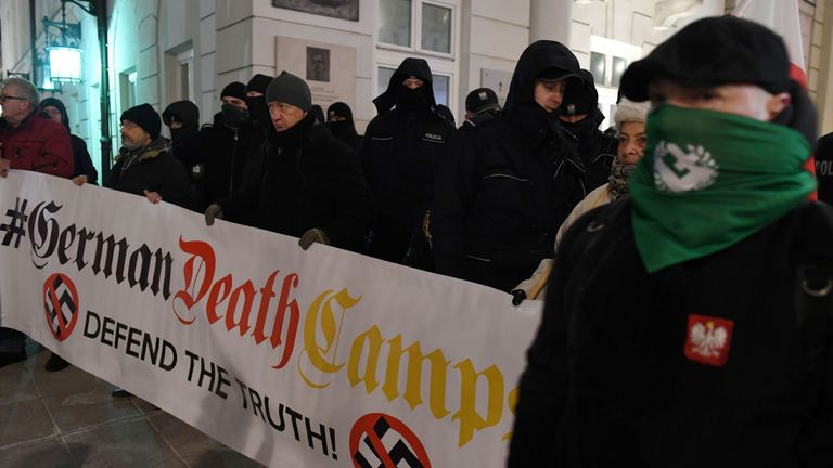 Far-right protesters hold a banner during a demonstration to support a controversial new Polish bill regarding the Holocaust and the definition of Nazi death camps on February 5, 2018 outside the presidential palace in Warsaw. The legislation, which still needs President Andrzej Dudas signature to take effect, is intended to stop people from erroneously describing Nazi German death camps as being Polish. / AFP PHOTO / JANEK SKARZYNSKI (Photo credit should read JANEK SKARZYNSKI/AFP/Getty Images)