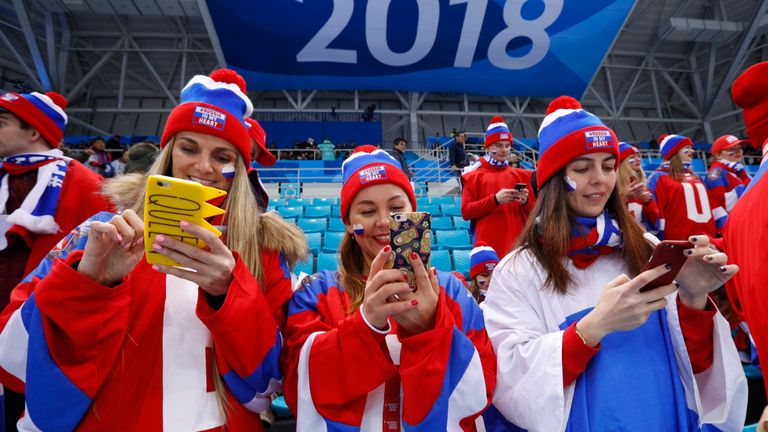 Ice Hockey - Pyeongchang 2018 Winter Olympics - Men's Quarterfinal Match - Olympic Athletes from Russia v Norway - Gangneung Hockey Centre, Gangneung, South Korea - February 21, 2018 - Russia fans check their phones before the game