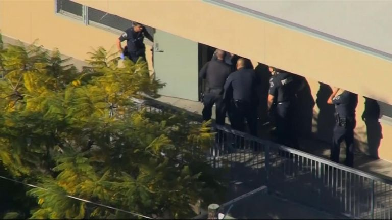 Police search the school for the suspect