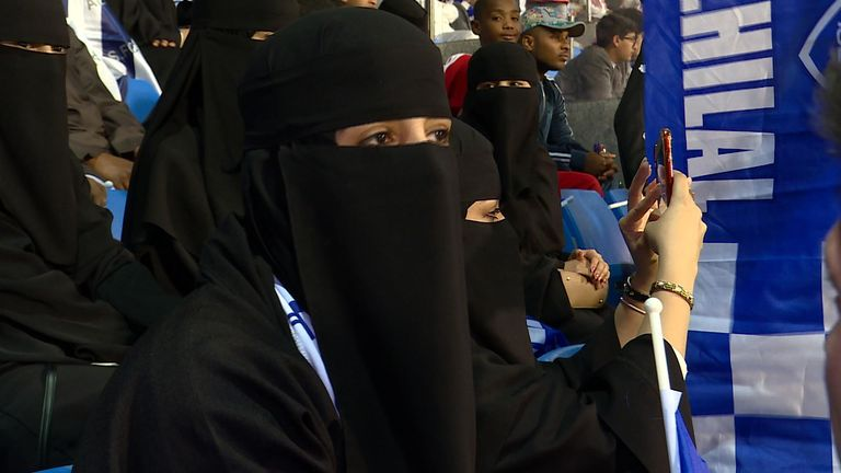 A Saudi woman watching a football match