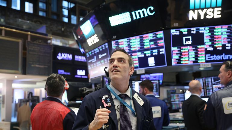 Traders work on the floor of the New York Stock Exchange (NYSE) on February 6, 2018 in New York City. Following Monday's over 1000 point drop, the Dow Jones Industrial Average closed up over 500 points