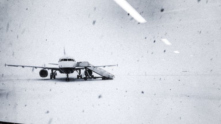 Heavy snow falls on the tarmac of Glasgow Airport