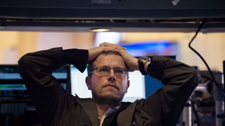 A trader is shown on the floor of the New York Stock Exchange at the closing bell on Monday