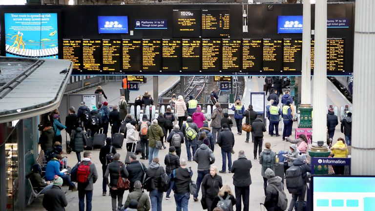 Commuters waiting for trains in Edinburgh's Waverley station
