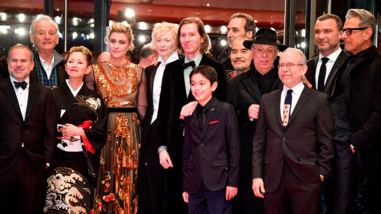 The team of the opening movie 'Isle of Dogs', among them (2ndL-R) US actor Bill Murray, Japanese actress Mari Natsuki, US actress Greta Gerwig and British actress Tilda Swinton, US director Wes Anderson Canadian-born actor Koyu Rankin, French Composer Alexandre Desplat, US actor Bob Balaban, US actor Liev Schreiber and US actor Jeff Goldblum pose with Berlinale Director Dieter Kosslick (4thR) on the red carpet for the opening ceremony of the 68th Berlinale film festival with the premiere of thei