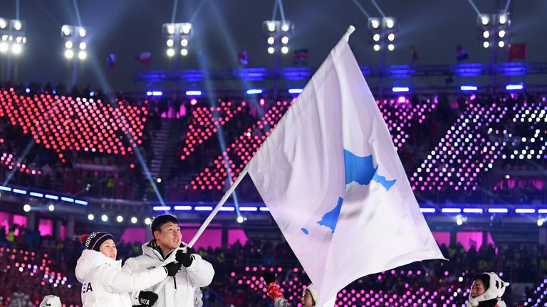 Flag bearers Chung Guam Hwang and Yunjong Won of Republic of Korea leads the team during the Opening Ceremony of the PyeongChang 2018 Winter Olympic Games