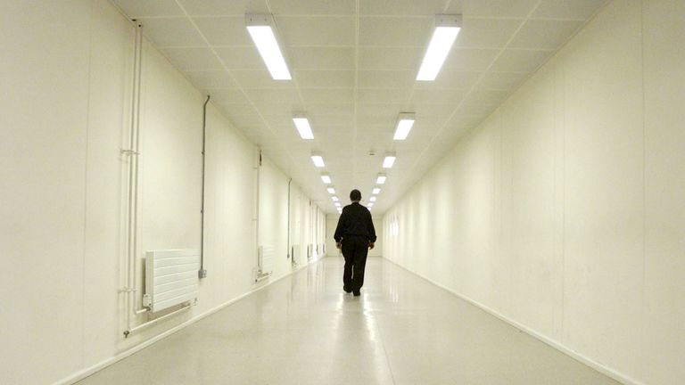 A Group Four security officer patrols the corridors