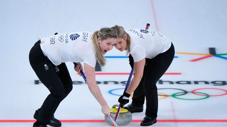 Britain's Lauren Gray (L) and Britain's Vicki Adams brush in front of the stone at the  Winter Olympic Athletes