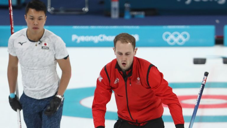 Chris Smith, Kyle Waddell and Kyle Smith of Great Britain compete during the Curling Men's Round Robin