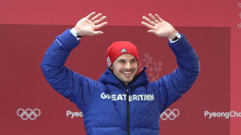 Team GB's Dom Parsons celebrates getting a bronze medal in the Skeleton