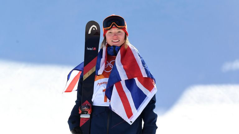 Team GB's Izzy Atkin celebrates on the podium after winning bronze in the ski slopestyle