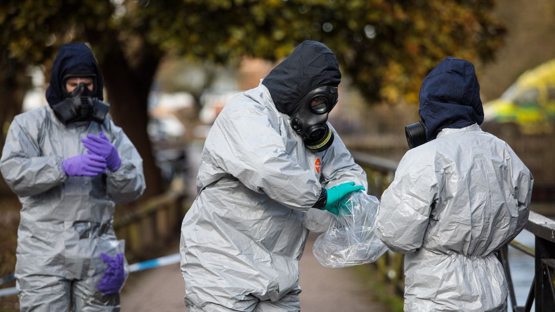 Police officers in protective suits and masks at the scene of the nerve agent attack