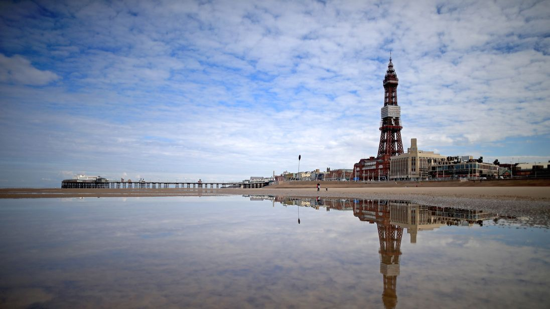 Blackpool Tower EVACUATED as blaze breaks out - with 12 stuck on roof