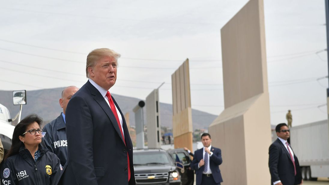 President Donald Trump (C) inspects border wall prototypes in San Diego