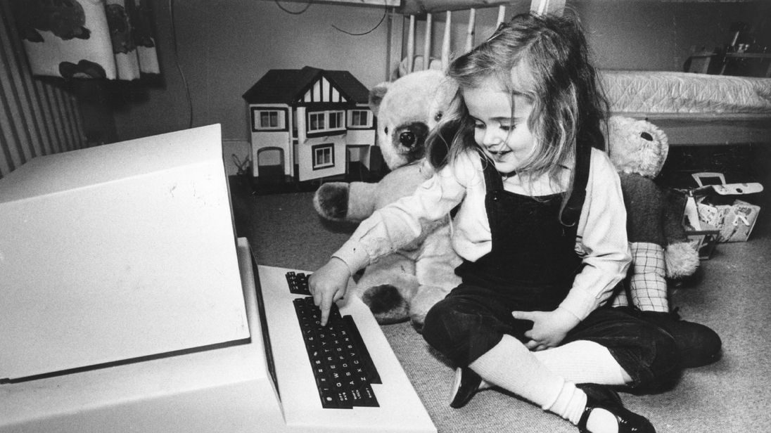 8th May 1980: Four-year-old Antonia Salmon with one of her birthday presents,a computer which used to belong to her father. (Photo by Hulton Archive/Getty Images)