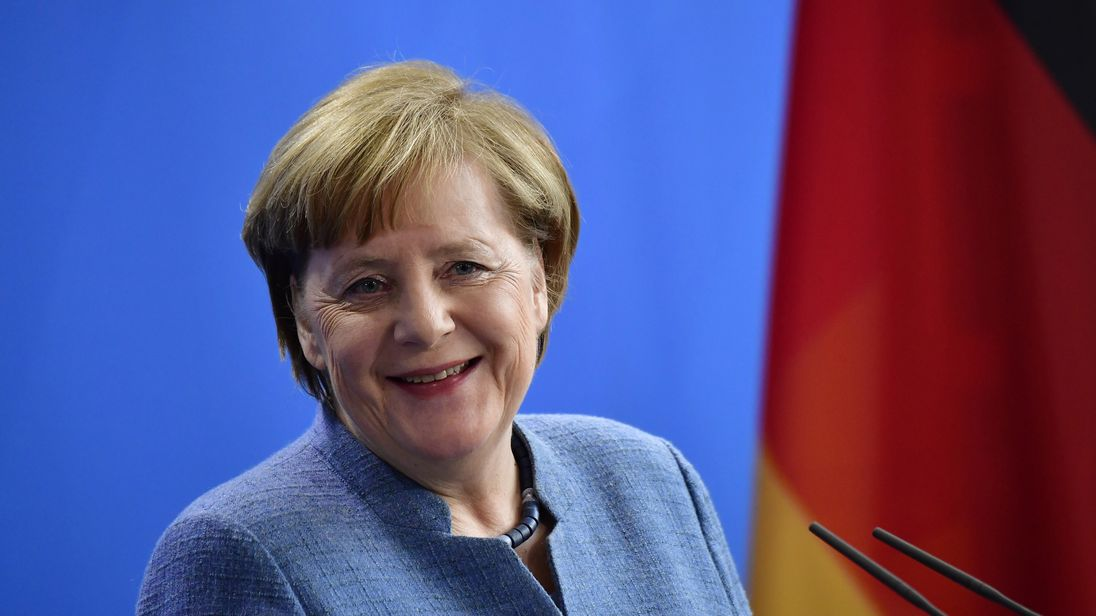 German Chancellor Angela Merkel has been back to work while the members voted