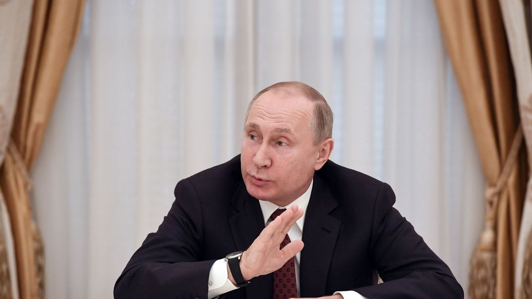Putin says will engage with West after record vote win class=
