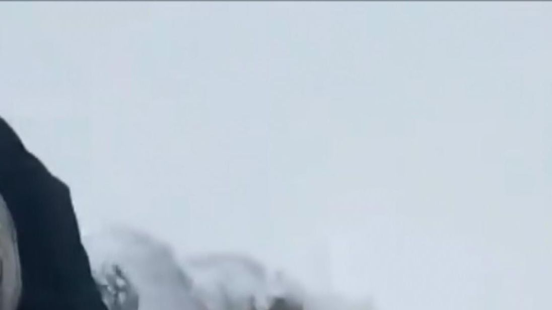 A farmer had to rush to save a sheep stuck in a snow drift on March 3 following heavy snowfall in Powys, Wales, and was recorded digging through the snow to find the place where the sheep was stuck.