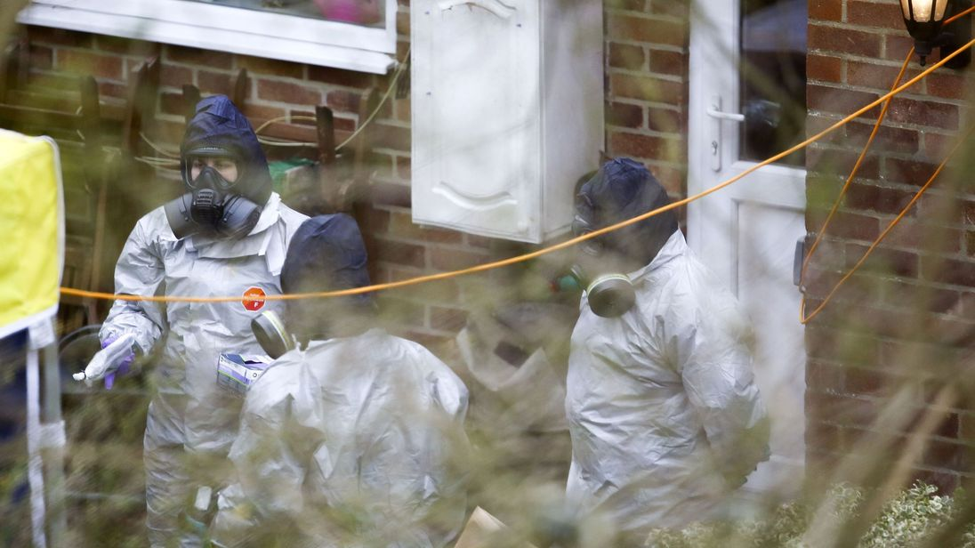 Investigators work in the garden of Sergei Skripal's house in Salisbury