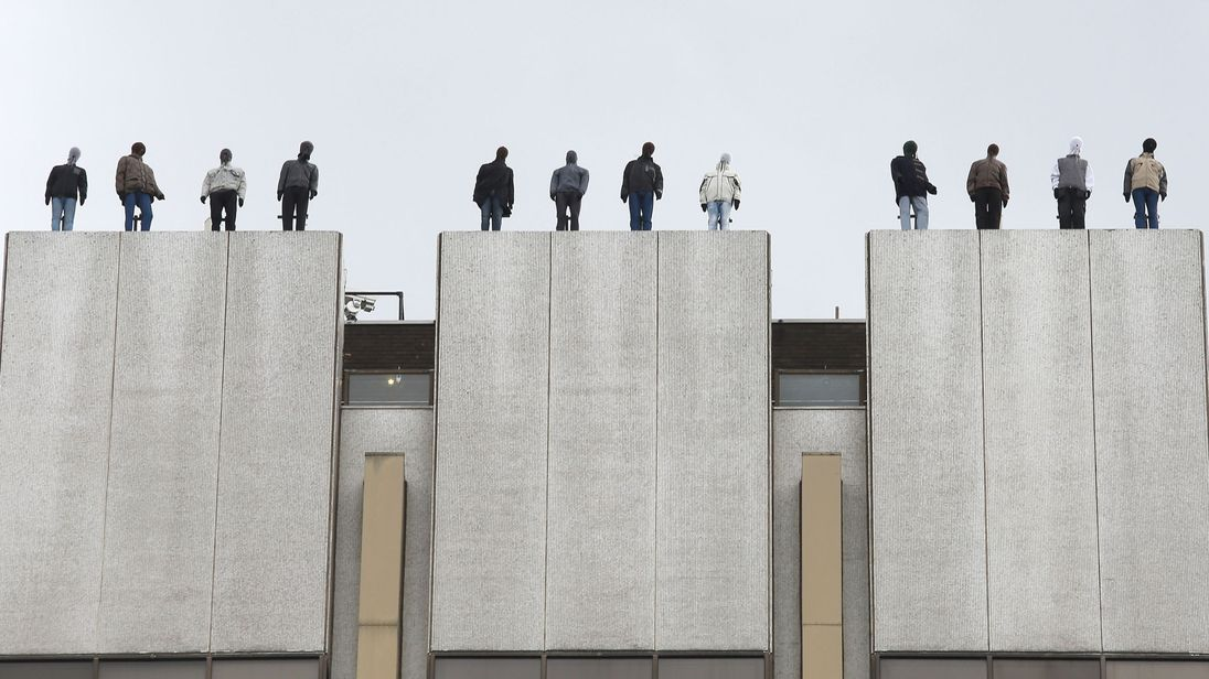 The sculptures of 84 men, made by American artist Mark Jenkins and his collaborator, Sandra Fernandez, part of Project 84, a campaign to raise awareness of the fact that 84 men take their own lives every week in the UK, ontop of London Television Centre after the installation was unveiled