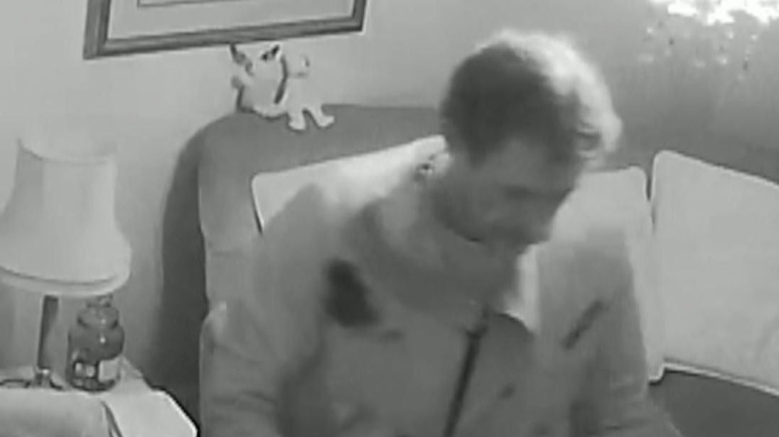 """Anyone with information can call Bromley CID on 07818 454 470, Tweet @MetCC or contact Crimestoppers on 0800 555 111 to remain anonymous.  The intruder was filmed forcing his way through the bedroom window of the 90-year-old's home in Bromley, south-east London, before rifling through her possessions. When the victim, who has Alzheimer's, asked him what he was doing, he  replied: """"I am looking for jewellery,"""" and carried on searching her dresser and bedside table, before prowling around her livi"""