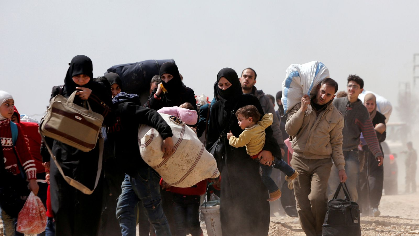 War in Syria: Thousands flee as dozens killed in eastern Ghouta and Afrin