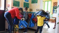 Children arrive in a classroom at the Gavarnie-Gedre primary school, on March 16, 2018