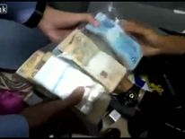 Packets of cash found by police at the home of Bishop Ribeiro