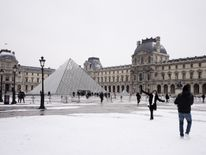 The Louvre Pyramid after overnight snowfall in Paris