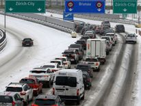 Traffic stacks up on the snow-covered A3 motorway near Zurich, Switzerland