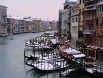Snow covered gondola's on Canal Grande in Venice lagoon